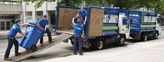 Truck team members loading junk onto a 1800-GOT-JUNK? truck