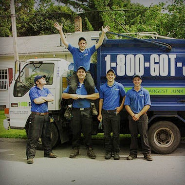 Truck team members in front of a 1800-GOT-JUNK? truck