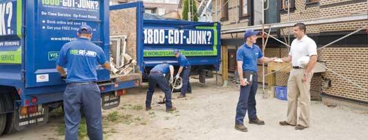 Truck team members loading junk on 1800-GOT-JUNK? trucks