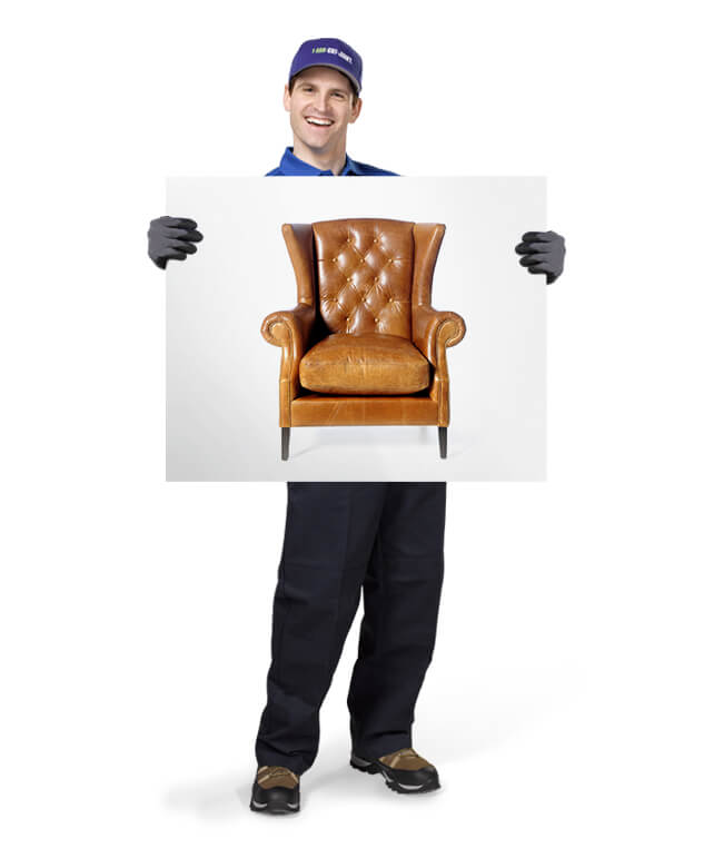 Truck team member holding photo of a sofa