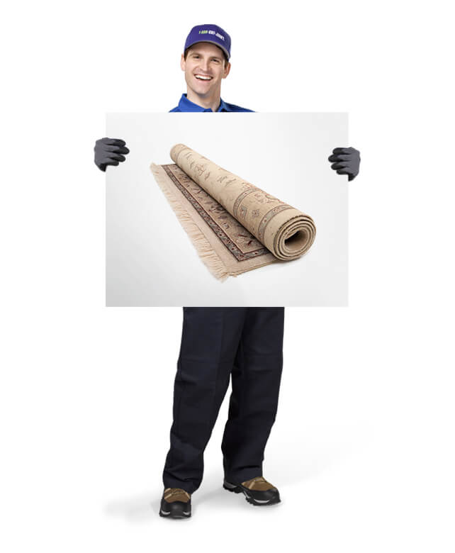 Truck team member holding photo of a carpet