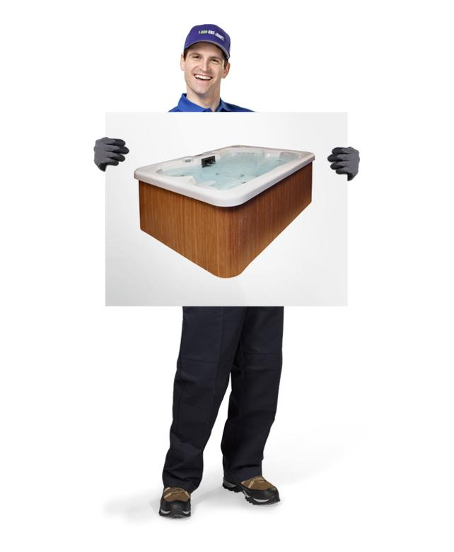 Truck team member holding photo of a hot tub