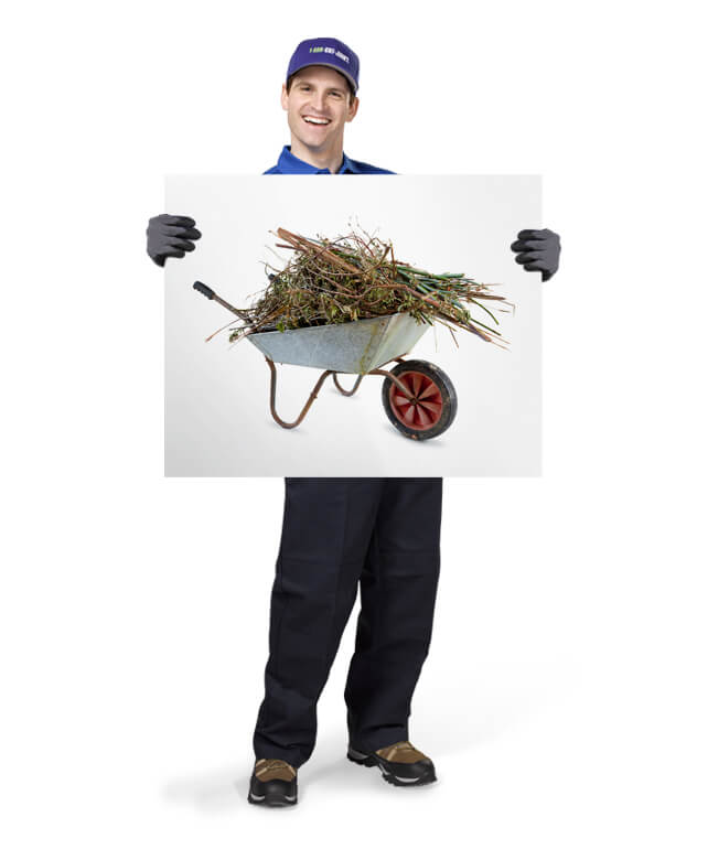 Uniformed TOM ready to remove & dispose of your yard waste